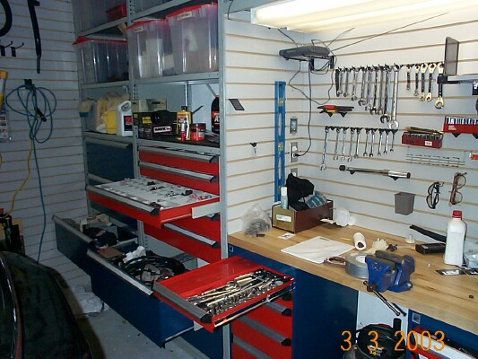 Here is a couple of pics that might give you some ideas  I used slotwall  instead of drywall   easy to install  not too expoensive  and really  versatile. Garage remodel   Pelican Parts Technical BBS