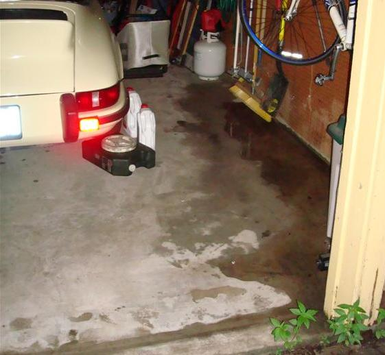 Water Coming Thru Garage Door And Puddling How To Fix