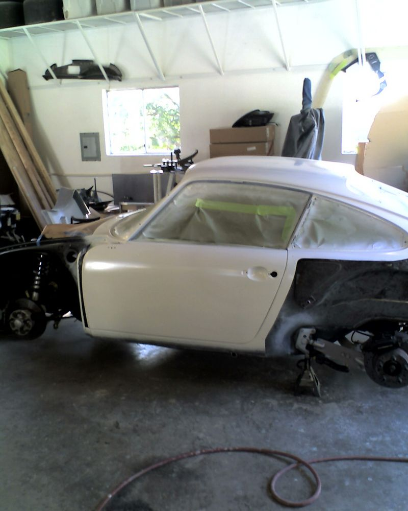 Masked and sprayed chassis and glass panels with white sealer