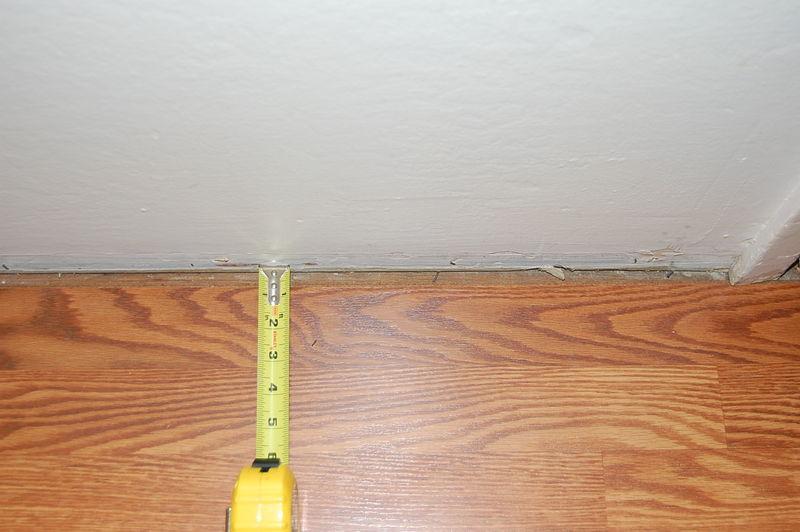 Laminate flooring big expansion gap laminate flooring for Wood floor expansion gap