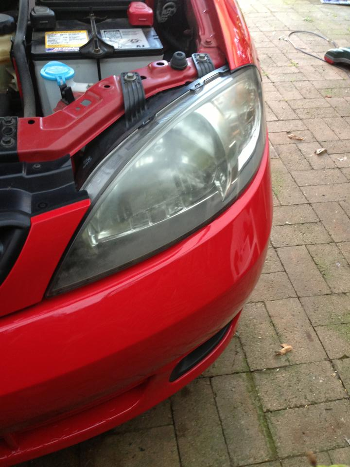 how to clean dull plastic headlight lenses