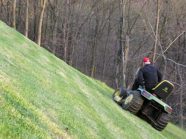 how to cut grass on a steep slope